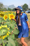 Women Thai Portrait on Sunflower Field at Saraburi Thailand Stock Image