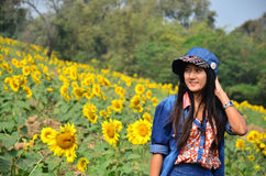 Women Thai Portrait on Sunflower Field at Saraburi Thailand. The sunflower (Helianthus annuus) is an annual plant native to the Americas. It possesses a large stock photo