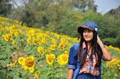 Women Thai Portrait on Sunflower Field at Saraburi Thailand Stock Photo