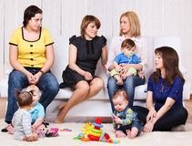 Women and their children Stock Images