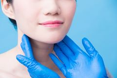 Women with thyroid gland problem. On the blue background stock image