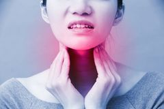 Women with thyroid gland problem. On the blue background royalty free stock image