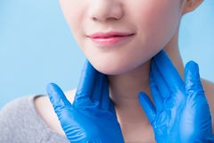 Women with thyroid gland problem. On the blue background royalty free stock images