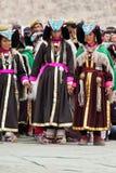 Women in Tibetan clothes performing folk dance Stock Photo