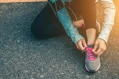 Women tied up the shoe laces prepare to run. Stock Images