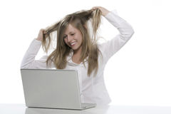 Women to the computer that you pull hair Royalty Free Stock Photo