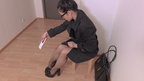 Women to put on shoes and goes away. In room stock video