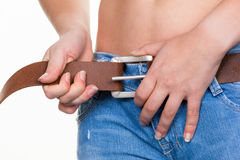 Women to tighten our belts Stock Photography