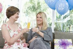Women Toasting Drinks At Baby Shower Royalty Free Stock Photography