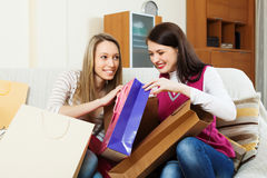 Women together looking purchases Royalty Free Stock Photography
