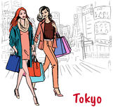 Women in Tokyo. Women friends with shoppping bags walking on street in Shibuya, Tokyo, Japan Stock Photography