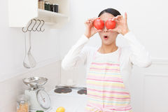 Women with tomato Stock Photography