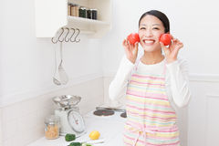 Women with tomato Stock Photos