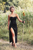 Women with with torches. Women are holding with torches in the forest Royalty Free Stock Image