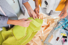 Women touching textile Stock Images