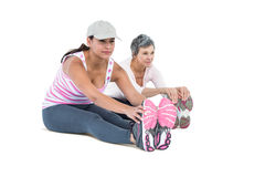 Women touching toes while exercising. On white backgorund Stock Image