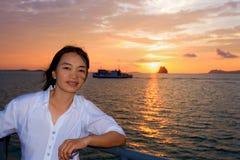Women tourist cruising at sunset Stock Photography