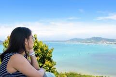 Women tourist looking the sea in Phuket, Thailand Stock Photos
