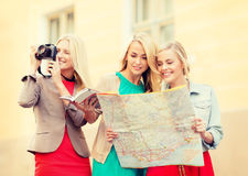 Women with tourist map and camera in the city Stock Images