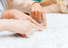 Women with tourist map in the city Stock Photography