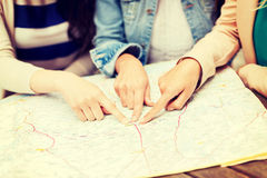 Women with tourist map in the city Royalty Free Stock Photos