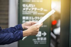 Women with tourist map in Japan. Close up royalty free stock photography