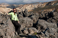 Women tourist posing on the lava field Stock Photography