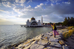 A women tourist taking a picture of Majestic view of Malacca Str Royalty Free Stock Photos