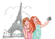 Women tourists at Eiffel Tower making travel selfie Royalty Free Stock Photos