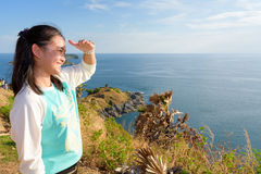 Women tourists looking at beautiful nature sea Stock Images