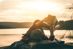 Women tourists read books. Women tourists read books in quiet nature Stock Photography