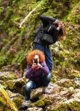 Women tourists taking photos Stock Images