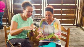 Women Tourists Tasting Fresh Handmade Cocoa Paste. Ecuador stock video footage
