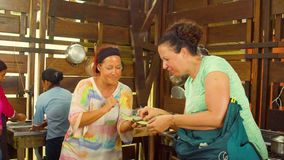 Women Tourists Tasting Freshly Made Cocoa Paste. Ecuador stock footage