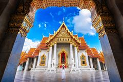 Women tourists at Wat Benchamabophit or the Marble Temple in Bangkok, Thailand royalty free stock photography