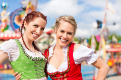 Women in traditional Bavarian clothes or dirndl on festival. Young women in traditional Bavarian clothes - dirndl or tracht - on a festival or Oktoberfest royalty free stock image