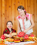 Women in traditional  clothes with pancake Stock Photo