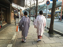 Women in the traditional dress walking on street in Arashiyama, Japan. Women in the traditional dress walking on street in Arashiyama, Kyoto, Japan Stock Photos