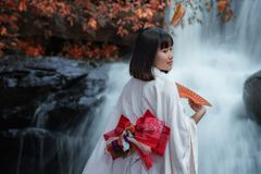 Women in traditional japanese kimono. With waterfall,young pretty geisha in kimono Royalty Free Stock Images