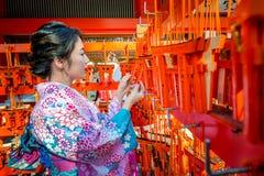 Women in traditional japanese kimonos at Fushimi Inari Shrine in Kyoto, Japan Stock Photo