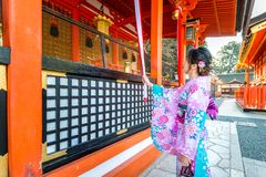 Women in traditional japanese kimonos at Fushimi Inari Shrine in Kyoto, Japan royalty free stock images