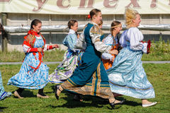 Women in traditional russian dress run Royalty Free Stock Image