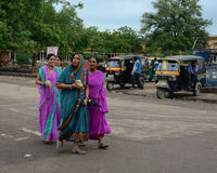 Women in traditional saree walking on street in Jaipur, India Royalty Free Stock Images