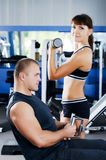 The woman with the trainer in sports club Royalty Free Stock Photography