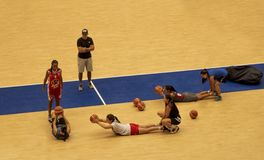 Women training basketball in coliseum royalty free stock photography