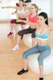 Women training with dumbbells. Stock Photos