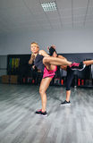 Women training kick boxing in the gym Stock Images