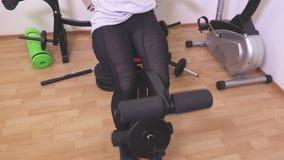Women training legs. In room stock video footage