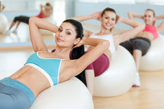Women training their abs. Stock Images
