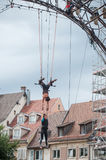 Women training on trapeze for an outdoor aerobatics show in the main place of Mulhouse Stock Image